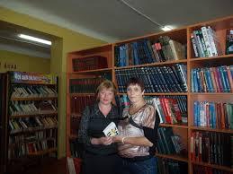 Белогорцы получали приз за запись друга в библиотеку
